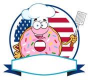 El cocinero Donut Cartoon Character con asperja sobre una etiqueta del espacio en blanco del círculo en Front Of Flag Of los E.E. Fotos de archivo libres de regalías