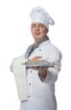 El cocinero mira fijamente usted con una bandeja Fotografía de archivo