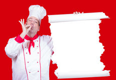 el cocinero ofrece un menú Fotografía de archivo
