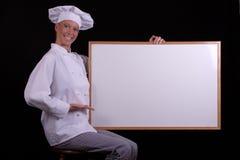 El cocinero presenta a la tarjeta blanca Fotos de archivo libres de regalías