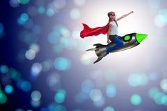 El cohete del vuelo de la niña en concepto del super héroe Fotografía de archivo libre de regalías