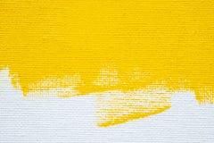 El color blanco del amarillo de la frontera del grunge del fondo amarillo abstracto con la lona blanca afila, textura del fondo d fotografía de archivo