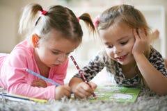 El colorear de las niñas Imágenes de archivo libres de regalías