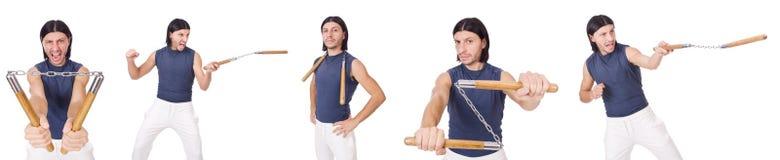 El combatiente divertido del karate con los nunchucks Fotografía de archivo libre de regalías