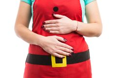 El comer excesivamente de la Navidad o concepto abdominal del dolor de la indigestión imagenes de archivo