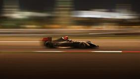 El competir con de coche de carreras en la velocidad Imagen de archivo libre de regalías