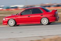 El competir con de coche rojo Imágenes de archivo libres de regalías