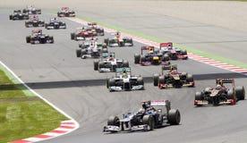 El competir con de coches de la fórmula 1 Imagen de archivo