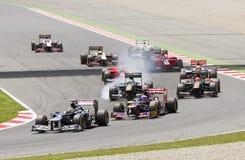 El competir con de coches de la fórmula 1 Fotografía de archivo libre de regalías