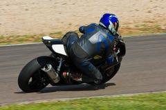 El competir con de la moto. Fotografía de archivo