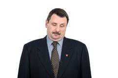 El comunista con la barbilla doble mira abajo Imágenes de archivo libres de regalías