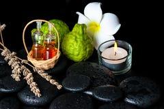 El concepto aromático del balneario de botellas aceite esencial, bergamota da fruto Foto de archivo