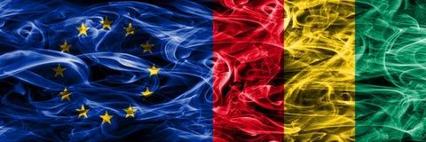 El concepto colorido de la unión y de Guinea de Europa fuma el lado puesto las banderas ilustración del vector
