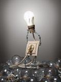 El concepto de bombillas de la evolución imagen de archivo