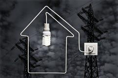 El concepto de casas de suministro de electricidad Imagenes de archivo