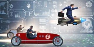 El concepto de la competencia con los hombres de negocios de la competición imágenes de archivo libres de regalías
