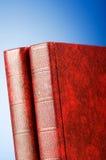 El concepto de la educación con los libros rojos de la cubierta Fotos de archivo libres de regalías