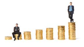 El concepto de riqueza y de pobreza Imágenes de archivo libres de regalías