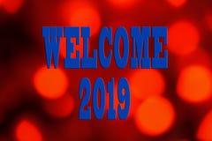 EL CONCEPTO DEL AÑO NUEVO 2019 CON EL TEXTO DA LA BIENVENIDA A 2019 SOBRE BACKGR BORROSO imagen de archivo