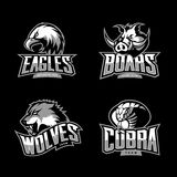 El concepto furioso del logotipo del vector del deporte de la cobra, del lobo, del águila y del verraco fijó en fondo oscuro Fotografía de archivo libre de regalías