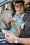 El conductor joven está muy enojado Foto de archivo libre de regalías