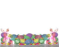 El conejito de la frontera de Pascua eggs el caramelo Imágenes de archivo libres de regalías