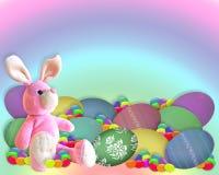 El conejito de la frontera de Pascua eggs el caramelo Imagen de archivo libre de regalías