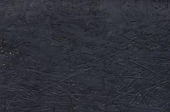 El conglomerado negro también llamó el tablero de madera aglomerada Textura del fondo Imagen de archivo libre de regalías