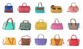 El conjunto de bolsos femeninos multicolores en un background 15 pedazos Foto de archivo libre de regalías