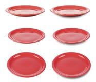 El conjunto de placas redondas rojas isoated en blanco Imagen de archivo libre de regalías