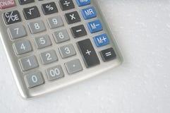 El considerar añade el concepto de sobra del cálculo de la calculadora del número Imagen de archivo libre de regalías