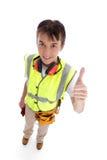 El constructor del aprendiz manosea con los dedos para arriba Fotografía de archivo libre de regalías