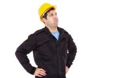 El constructor del ingeniero mira para arriba y suspira Imágenes de archivo libres de regalías