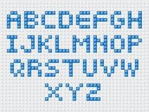 El constructor pone letras al azul Foto de archivo libre de regalías