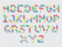 El constructor pone letras a color Fotografía de archivo libre de regalías