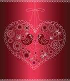 El corazón adornado con los pájaros y las flores. Fotografía de archivo