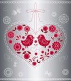 El corazón adornado con los pájaros y las flores. Imagen de archivo