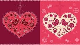 El corazón adornado con los pájaros y las flores. Fotos de archivo