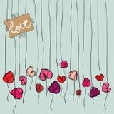 El corazón de la tarjeta del día de San Valentín florece el fondo Fotografía de archivo
