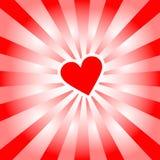 El corazón de la tarjeta del día de San Valentín irradia rayos rojos del amor Imágenes de archivo libres de regalías