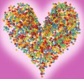 El corazón de los círculos coloreados en fondo púrpura Imagen de archivo libre de regalías