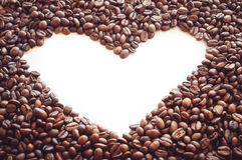 El corazón del café en el blanco aisló el fondo Fotografía de archivo