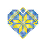 El corazón hizo el ornamento de un color del punto de cruz, amarillo y azul, ornamento ucraniano, ejemplo del vector Foto de archivo libre de regalías