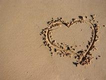 El corazón rasguñó en la arena Fotografía de archivo libre de regalías