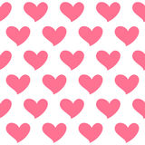 El corazón rosado aisló el modelo inconsútil en el fondo blanco Símbolo del amor Fotos de archivo libres de regalías