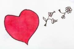 El corazón y las flores rosados se cierran encima de la mano Foto de archivo