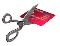 El cortar de las tijeras de la tarjeta de crédito Imágenes de archivo libres de regalías