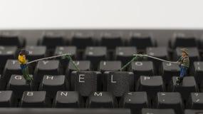 El cortar del ordenador de la ayuda Imagenes de archivo