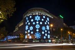 El Corte Ingles shopping mal. BARCELONA - NOVEMBER 24: El Corte Ingles shopping mall at night,  with traffic lights, on November 24, 2012 in Barcelona, Spain Stock Images