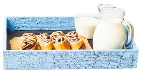 El corte y la leche del rollo Fotografía de archivo libre de regalías